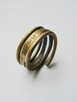 Another baltic inspired ring .  Make a metal ring in under 60 minutes by metalworking and wireworking with brass wire and brass stamping. Inspired by clothes & accessories. Creation posted by alpha.omega. Difficulty: Simple. Cost: Cheap.