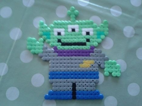 ALIEN .  Make a beaded character in under 60 minutes by creating and fusing with iron, perler beads, and hama bead ironing paper. Inspired by alien and toy story. Creation posted by . Difficulty: Simple. Cost: Absolutley free.