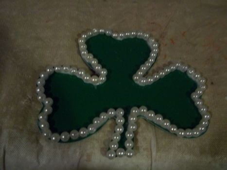 What a stud! .  Make a beaded flower in under 45 minutes by embellishing with glue, pearl beads, and cut out. Inspired by st patrick's day and shamrocks. Creation posted by Ashley P. Difficulty: Easy. Cost: No cost.