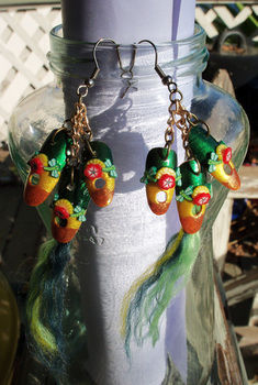 Tropical themed nails on earrings! Ver 1 .  Make a feather earring in under 30 minutes by nail painting and jewelrymaking with polymer clay, chain, and nail polish. Inspired by halloween, gothic, and costumes & cosplay. Creation posted by CiiMoore.  in the Jewelry section Difficulty: Simple. Cost: 3/5.
