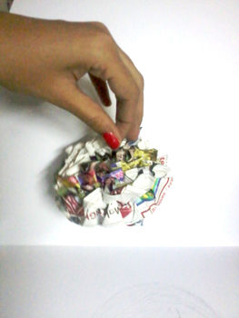 Pretty Decorations that can be made easily and quickly using newspaper or any paper!!! .  Free tutorial with pictures on how to make a Christmas decoration in under 20 minutes by creating, papercrafting, and paper folding with thread, newspaper, and paper scissors. Inspired by christmas. How To posted by Archana Kamal. Difficulty: Easy. Cost: Absolutley free. Steps: 9