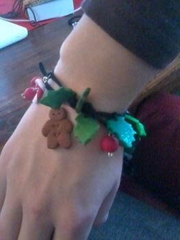 Create a fun bracelet using Fimo and a leather string! .  Sculpt a clay character bracelet in under 180 minutes by beading and jewelrymaking with polymer clay and leather string. Inspired by christmas, kawaii, and clothes & accessories. Creation posted by mimilover. Difficulty: Easy. Cost: 3/5.