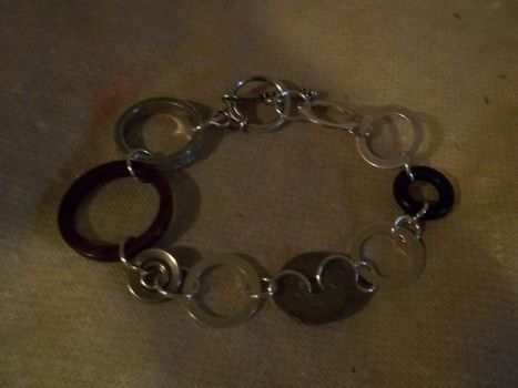 Linked! .  Make a metal hoop bracelet in under 15 minutes by jewelrymaking with jump rings, clasps, and pendants. Inspired by shapes and clothes & accessories. Creation posted by Ashley P. Difficulty: Easy. Cost: Absolutley free.