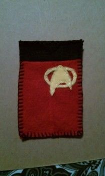 Star trek phone case .  Make a pouch, purse or wallet in under 120 minutes by creating, constructing, needleworking, embroidering, and sewing with felt. Inspired by christmas, star trek, and geeky. Creation posted by Grace . Difficulty: Easy. Cost: Cheap.
