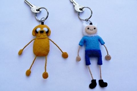 Best friends keyrings for Adventure Time fans! .  Free tutorial with pictures on how to sew a fabric character charm in 37 steps by needleworking and sewing with felt, ribbon, and acrylic paint. Inspired by christmas, costumes & cosplay, and kawaii. How To posted by Lauren. Difficulty: Simple. Cost: Absolutley free.