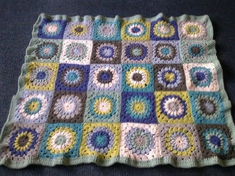 Cute granny squares! .  Crochet a granny square blanket by crocheting with yarn and crochet hook. Creation posted by Libby W. Difficulty: Simple. Cost: 3/5.
