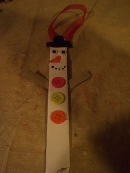 Let it snow!! .  Make a Christmas decoration in under 10 minutes by decorating and embellishing with buttons, paper, and cardboard. Inspired by christmas, snowmen, and snowman. Creation posted by Ashley P. Difficulty: Easy. Cost: Absolutley free.