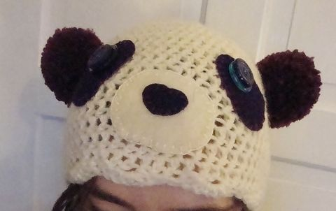 Cute and quirky purple panda hat. .  Make an animal hat by crocheting with felt, buttons, and worsted weight yarn. Inspired by christmas, kawaii, and pandas. Creation posted by Helen W. Difficulty: Simple. Cost: 3/5.
