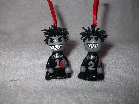 Meet the Bad Things 1 & 2, Be careful or they'll kill you.  .  Make a bauble by baking, decorating, embellishing, and potting with acrylic paint and polymer clay. Inspired by christmas, halloween, and gothic. Creation posted by Jessy. Difficulty: 5/5. Cost: No cost.