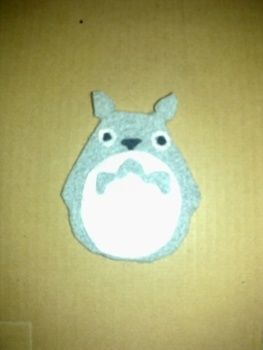 Totoro felt badges, super cute! .  Sew a fabric character brooch in under 10 minutes by needleworking and felting with felt, safety pins, and fabric glue. Inspired by gifts, japanese, and anime & manga. Creation posted by susie. Difficulty: Easy. Cost: Absolutley free.