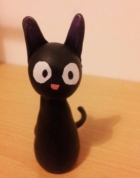 """A little clay model of Jiji from """"Kiki's Delivery Service"""" .  Sculpt a clay cat in under 120 minutes using paint, polymer clay, and nail polish. Inspired by halloween, cats, and my neighbor totoro. Creation posted by Hayley S. Difficulty: Easy. Cost: Cheap."""