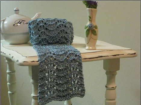 An easy lace pattern knit with yarn that glistens and shines. .  Free tutorial with pictures on how to knit a lace knit scarf in under 180 minutes by knitting with yarn and knitting needles. How To posted by Stacy L. Difficulty: Easy. Cost: 3/5. Steps: 6