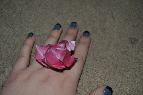 Your hand is as darling as a rose! .  Make a paper ring in under 60 minutes by jewelrymaking and paper folding with hot glue gun, ring base, and origami paper. Inspired by flowers, clothes & accessories, and roses. Creation posted by Oriana F. Difficulty: 3/5. Cost: Absolutley free.