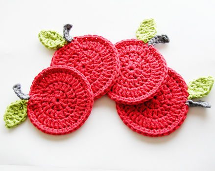 Crochet some apple coasters .  Free tutorial with pictures on how to stitch a knit or crochet coaster in under 15 minutes by crocheting with crochet hook and cotton. Inspired by apples. How To posted by AnnemariesCrochetBlog. Difficulty: Easy. Cost: Cheap. Steps: 1