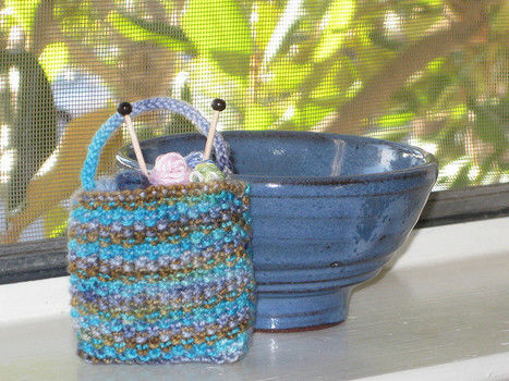This miniature knitting bag can be completed in an afternoon and makes an excellent ornament or gift for a knitting friend. It's also a great way to use up leftover sock yarn. .  Free tutorial with pictures on how to make a knit or crochet tote in 14 steps by knitting with yarn, yarn, and knitting needles. How To posted by Stacy L. Difficulty: Easy. Cost: Cheap.
