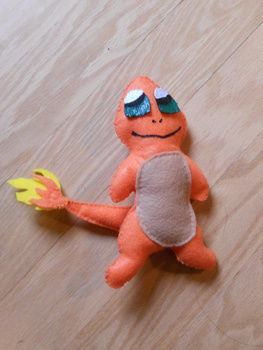 For the Pokemon trainers! <3 .  Free tutorial with pictures on how to make a Pokemon plushie in 15 steps by sewing with felt, felt, and felt. Inspired by pokemon. How To posted by Hannah Elizabeth. Difficulty: Simple. Cost: Cheap.