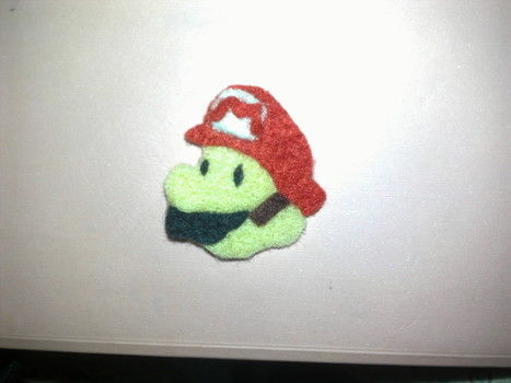 Wee badge I made. .  Sew a fabric character brooch in under 30 minutes by needleworking with felt, fabric glue, and safety pins. Inspired by gifts, super mario, and geeky. Creation posted by susie. Difficulty: Easy. Cost: Absolutley free.