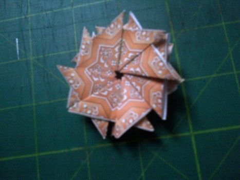 Turn a greetins card into a 3D one .  Free tutorial with pictures on how to fold an origami shape in 5 steps by papercrafting, cardmaking, and paper folding with paper and glue stick. Inspired by stars. How To posted by TinyTessieG. Difficulty: Easy. Cost: No cost.