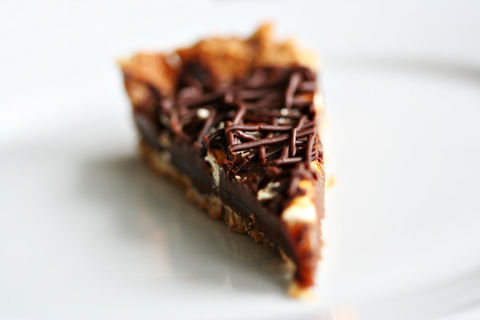 A pretzel crust, filled with rich ganache and smooth caramel. .  Free tutorial with pictures on how to bake a chocolate tart in 6 steps by cooking and baking with water, salt, and eggs. Recipe posted by Amanda H. Difficulty: 3/5. Cost: 3/5.
