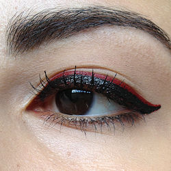 Embrace powerful red lips by pairing them with matching red eyeliner .  Free tutorial with pictures on how to create a red eye makeup look in under 20 minutes by applying makeup and applying makeup with eyeliner, mascara, and lipstick. How To posted by thebeautymilk. Difficulty: Simple. Cost: 3/5. Steps: 4