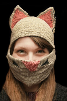 Kitten Cap/Face warmer .  Make an animal hat in under 120 minutes by sewing and knitting with sewing machine, sweater, and knit fabric. Inspired by cats and clothes & accessories. Creation posted by ZanyDays. Difficulty: Simple. Cost: No cost.