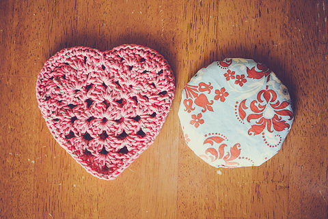 Rice pack and crochet heart cozy. .  Free tutorial with pictures on how to make a shape plushie in under 45 minutes by crocheting with sewing machine, crochet hook, and yarn needle. Inspired by valentine's day and hearts. How To posted by goodknits. Difficulty: Simple. Cost: No cost. Steps: 1