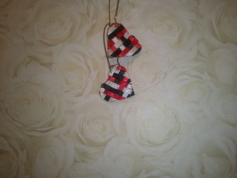 Woven Hearts .  Free tutorial with pictures on how to make a set of ribbon earrings in under 120 minutes by jewelrymaking and weaving with scissors, ribbon, and glue. Inspired by gifts, people, and hearts. How To posted by nicole.johnson.520. Difficulty: Simple. Cost: Cheap. Steps: 1