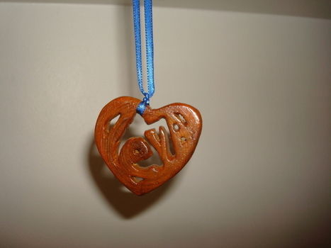 Pendant .  Make a wooden necklace by creating, drawing, and woodworking with varnish, drill, and saw. Inspired by gifts, hearts, and clothes & accessories. Creation posted by Ievars. Difficulty: 4/5. Cost: Cheap.