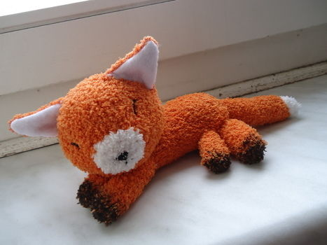 A cute fox made out of a piece of sock .  Free tutorial with pictures on how to make a fox plushie in 8 steps by needleworking and sewing with fabric marker, embroidery thread, and felt. Inspired by kawaii and foxes. How To posted by judithchen. Difficulty: Simple. Cost: Cheap.