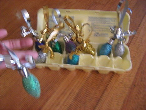 Easy kid friendly hand made gift .  Make a bauble in under 5 minutes by creating, decorating, and embellishing with bulb, glue, and ribbon. Inspired by gifts and christmas. Creation posted by meg s. Difficulty: Easy. Cost: No cost.