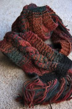 A warm cable knit for the winter months! .  Stitch a cable knit scarf using knitting needles and cable needle. Creation posted by ZanyDays. Difficulty: 3/5. Cost: No cost.