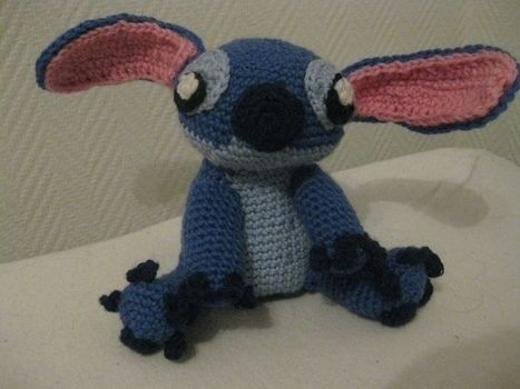 My favourite blue alien! .  Sew a cartoon plushie by yarncrafting and crocheting with yarn, crochet hook, and yarn needle. Inspired by gifts and lilo & stitch. Creation posted by . Difficulty: Easy. Cost: Cheap.