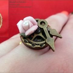 Handcoiled Ring With A Gear And A Rose