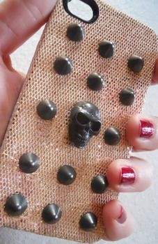 For those who love studs and skulls like me ** .  Free tutorial with pictures on how to make a phone case in under 80 minutes by studding and studding with super glue, permanent marker, and studs. Inspired by skulls & skeletons. How To posted by Serena A. Difficulty: Easy. Cost: Cheap. Steps: 1