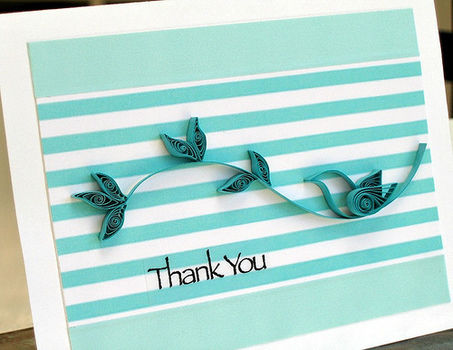 Shape strips of paper to make a little bird on a branch. .  Make a quilled greetings card in under 60 minutes by papercrafting, cardmaking, and quilling with scissors, ruler, and cardstock. Inspired by birds. Creation posted by Ann Martin. Difficulty: Simple. Cost: 3/5.