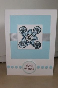 Blue tones for a sympathy card .  Embellish a ribbon card in under 40 minutes by cardmaking with ribbon, card, and stampers. Creation posted by Gemma T. Difficulty: Simple. Cost: Cheap.