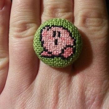 Getting your favourite video game charecters on jewelry .  Free tutorial with pictures on how to make a fabric ring in 3 steps by jewelrymaking and cross stitching with embroidery thread, cross stitch fabric, and ring blank. Inspired by fun & games, super mario, and geeky. How To posted by Owly Sh*t. Difficulty: Simple. Cost: Cheap.