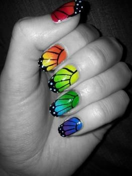 Beautiful butterfly wings in every colour of the rainbow :) .  Free tutorial with pictures on how to paint an animal nail in under 30 minutes by creating, applying makeup, nail painting, decorating, and nail painting with nail varnish, nail art pen, and clear nail varnish. Inspired by butterflies, butterflies, and people. How To posted by Jazmyn Annecia. Difficulty: Simple. Cost: No cost. Steps: 5