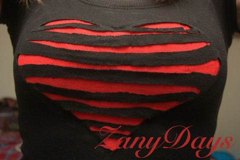 An upcycled Tee with a new style! .  Free tutorial with pictures on how to cut a heart cut-out top in under 40 minutes using scissors, t shirt, and t shirt. How To posted by ZanyDays. Difficulty: Easy. Cost: No cost. Steps: 6