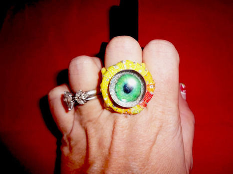 Eyebal Ring made from Glass Marbles and Recycled T-shirts .  Make a cabochon ring in under 140 minutes by jewelrymaking with flat sided marbles. Inspired by halloween, gothic, and steampunk. Creation posted by Fashion Diva Crochet. Difficulty: 4/5. Cost: Cheap.