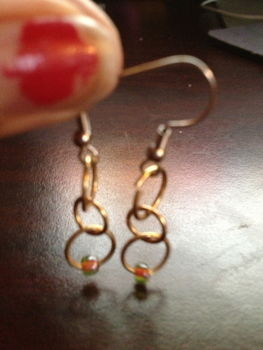 Sweet, simple, sophisticated. .  Make a pair of chainmaille earrings in under 5 minutes by beading, jewelrymaking, and chainmailing with beads, earring hooks, and beading hoop. Inspired by clothes & accessories. Creation posted by craftiequeen2000. Difficulty: Simple. Cost: Cheap.