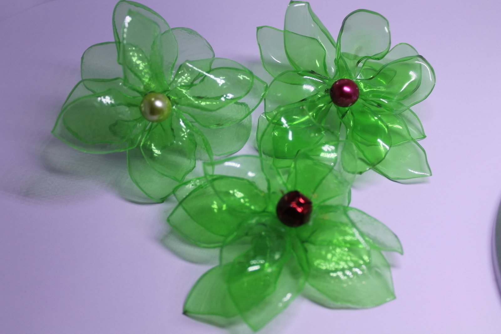 Recycled Plastic Flowers · A Recycled Headband · Art on Cut Out Keep