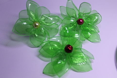 Pretty Flowers from recycled plastic beverage bottles!!! .  Make a recycled headband in under 85 minutes by creating with plastic bottle. Inspired by flowers and clothes & accessories. Creation posted by Wilma S. Difficulty: Simple. Cost: Cheap.