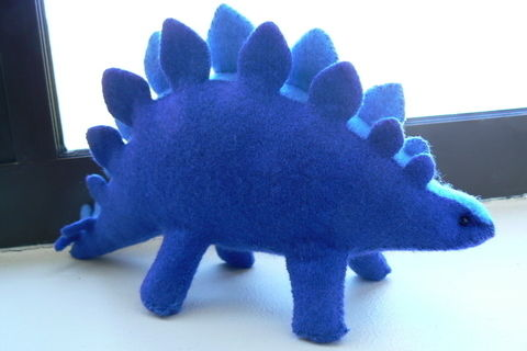 A sweet felt dino. .  Make a stegosaurus plushie in under 120 minutes by sewing with felt. Inspired by gifts, dinosaurs, and kawaii. Creation posted by Lauren. Difficulty: Simple. Cost: Cheap.