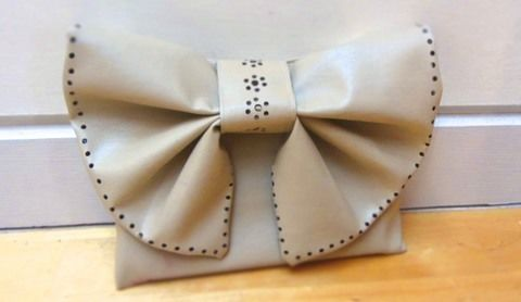 Stitch and punch a gorgeous bow clutch! .  Free tutorial with pictures on how to sew a bow clutch in under 180 minutes by sewing with scissors, sewing machine, and iron. How To posted by Cat Morley. Difficulty: 3/5. Cost: Cheap. Steps: 23