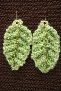 Knitted leaf earrings with beaded embellishments! .  Free tutorial with pictures on how to stitch a pair of knit or crochet earrings in under 60 minutes by knitting with yarn, knitting needles, and tapestry needle. Inspired by clothes & accessories. How To posted by ZanyDays. Difficulty: Easy. Cost: No cost. Steps: 3