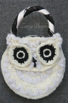 A colorful owl purse! .  Free tutorial with pictures on how to make an animal bag in under 180 minutes by yarncrafting and crocheting with yarn, crochet hook, and tapestry needle. Inspired by owls and clothes & accessories. How To posted by ZanyDays. Difficulty: Easy. Cost: No cost. Steps: 4