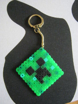 Minecraft Creeper Key Ring .  Free tutorial with pictures on how to make a pegboard bead charm in under 10 minutes by beading and fusing with perler beads, perler beads, and key ring. Inspired by crafts, gifts, and clothes & accessories. How To posted by Super Madcow. Difficulty: Easy. Cost: Cheap. Steps: 5