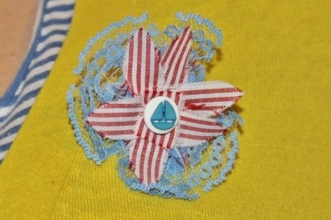 A nautical inspired brooch .  Free tutorial with pictures on how to make a ribbon brooch in under 60 minutes by sewing with fabric, thread, and buttons. Inspired by nautical, vintage & retro, and clothes & accessories. How To posted by Hope W. Difficulty: Simple. Cost: Cheap. Steps: 14