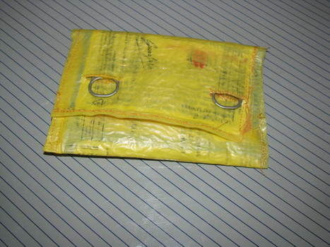 Love for fusing plastic bags .  Recycle a plastic bag pouch in under 40 minutes by fusing and sewing with iron and plastic bags. Inspired by clothes & accessories. Creation posted by PinKween. Difficulty: Easy. Cost: No cost.